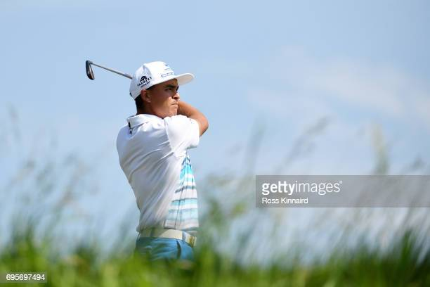 Rickie Fowler of the United States plays his shot from the 14th tee during a practice round prior to the 2017 US Open at Erin Hills on June 13 2017...