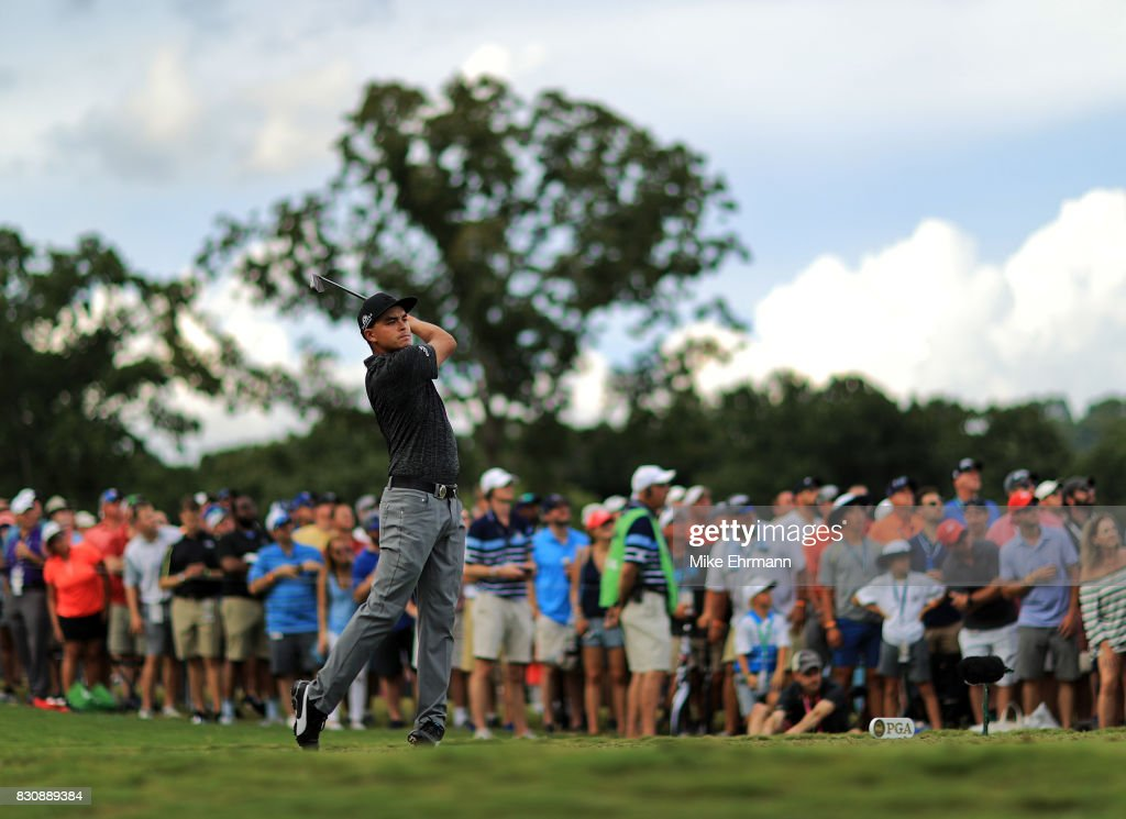 Rickie Fowler of the United States plays his shot from the 17th tee during the third round of the 2017 PGA Championship at Quail Hollow Club on August 12, 2017 in Charlotte, North Carolina.