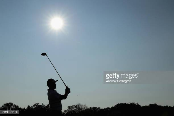 Rickie Fowler of the United States plays his shot from the 18th tee during round three of The Northern Trust at Glen Oaks Club on August 26 2017 in...