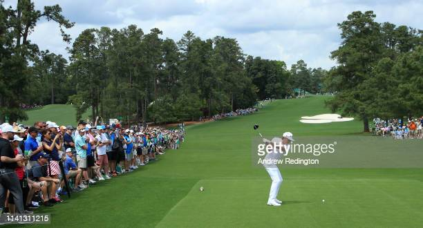 Rickie Fowler of the United States plays his shot from the eighth tee during a practice round prior to The Masters at Augusta National Golf Club on...