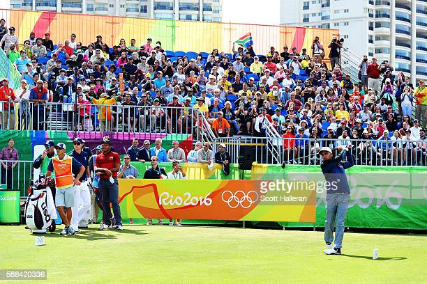Rickie Fowler of the United States plays his shot from the first tee during the first round of men's golf on Day 6 of the Rio 2016 Olympics at the...
