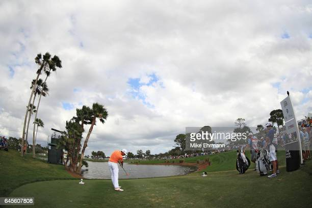 Rickie Fowler of the United States plays his shot from the ninth tee during the final round of The Honda Classic at PGA National Resort and Spa on...