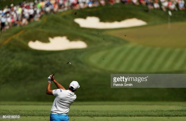 Rickie Fowler of the United States plays his shot from the ninth tee during the second round of the Quicken Loans National on June 30, 2017 TPC...