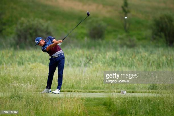 Rickie Fowler of the United States plays his shot from the second tee during the third round of the 2017 US Open at Erin Hills on June 17 2017 in...