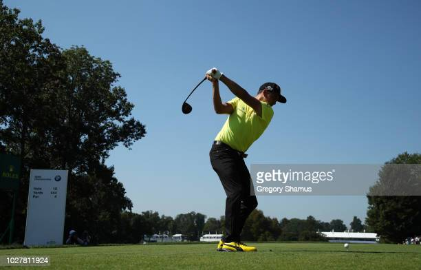 Rickie Fowler of the United States plays his shot from the tenth tee during the first round of the BMW Championship at Aronimink Golf Club on...