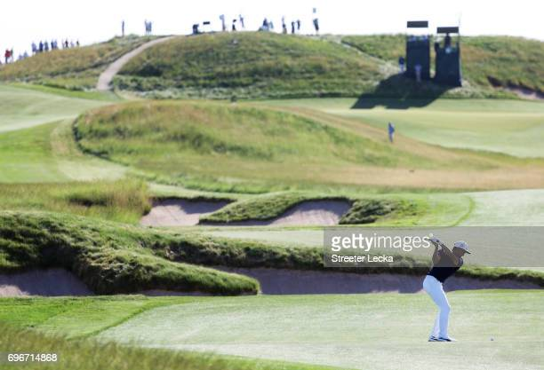 Rickie Fowler of the United States plays his shot on the 14th hole during the second round of the 2017 U.S. Open at Erin Hills on June 16, 2017 in...