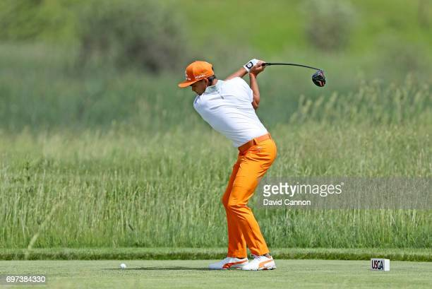 Rickie Fowler of the United States plays his tee shot at the par 4 second hole during the final round of the 117th US Open Championship at Erin Hills...