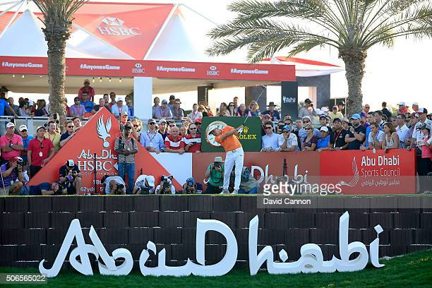 Rickie Fowler of the United States plays his tee shot at the par 5 18th hole during the final round of the 2016 Abu Dhabi HSBC Golf Championship at...