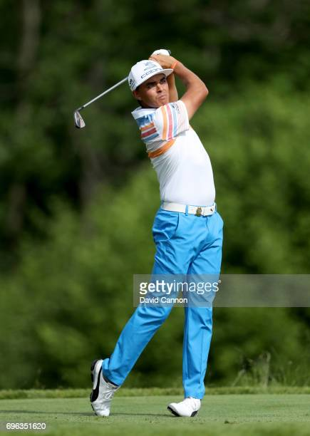 Rickie Fowler of the United States plays his tee shot on the par 3, 16th hole during the first round of the 117th US Open Championship at Erin Hills...