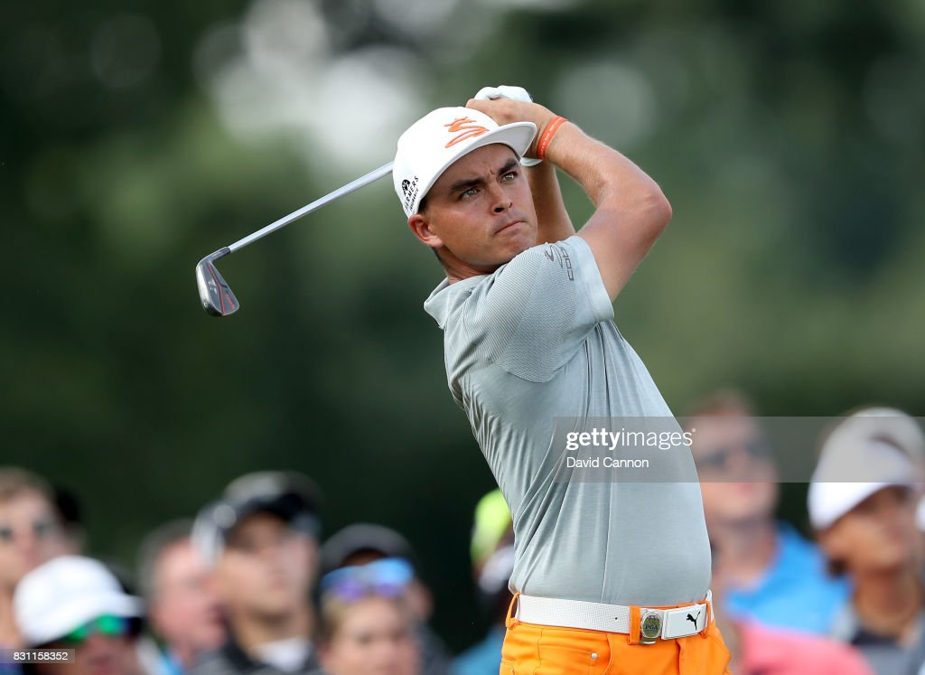 Rickie Fowler of the United States plays his tee shot on the par 3, 17th hole during the final round of the 2017 PGA Championship at Quail Hollow on August 13, 2017 in Charlotte, North Carolina.