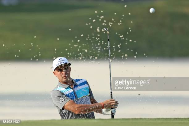 Rickie Fowler of the United States plays his third shot on the par 4 10th hole during the first round of THE PLAYERS Championship on the Stadium...