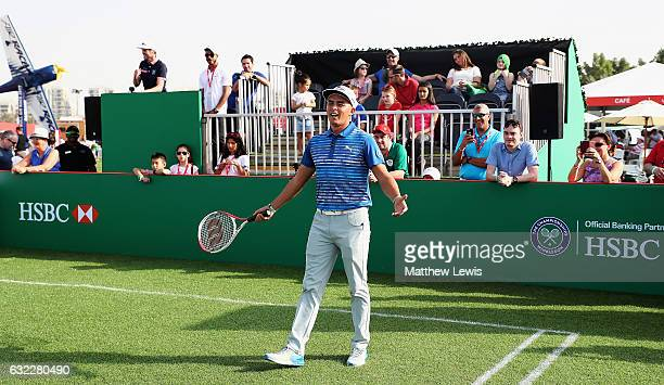 Rickie Fowler of the United States plays tennis with Tim Henman in the Championship village during day three of the Abu Dhabi HSBC Championship at...