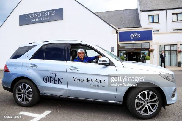 Rickie Fowler of the United States poses for a photograph in a Mercedes car during previews to the 147th Open Championship at Carnoustie Golf Club on...