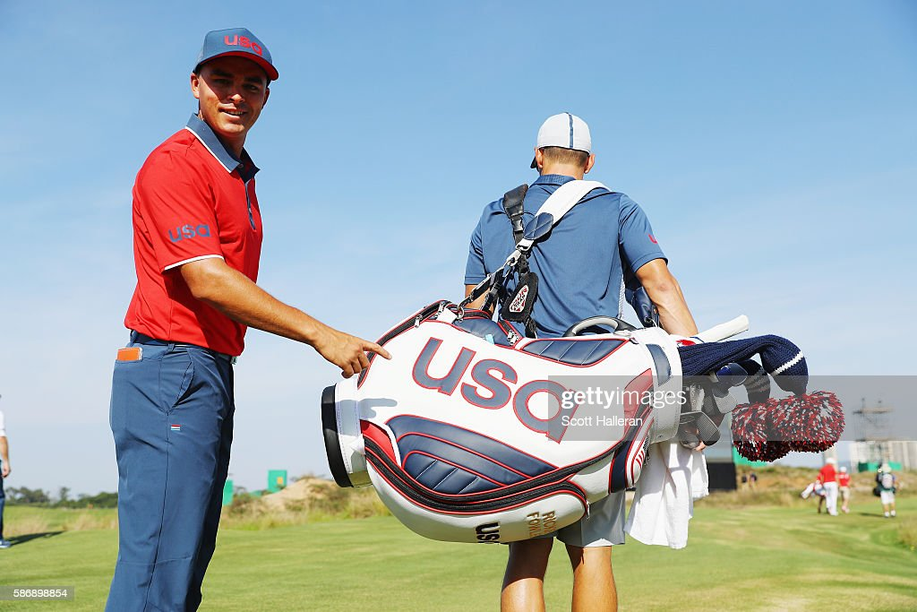 Rickie Fowler of the United States poses with his caddie Joe Skovron during a practice day during Day 2 of the Rio 2016 Olympic Games at Olympic Golf Course on August 7, 2016 in Rio de Janeiro, Brazil.