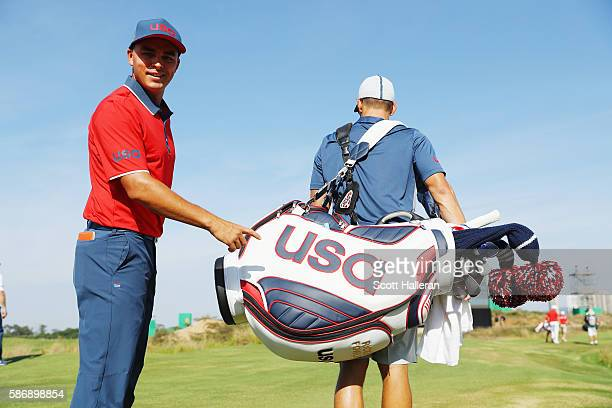 Rickie Fowler of the United States poses with his caddie Joe Skovron during a practice day during Day 2 of the Rio 2016 Olympic Games at Olympic Golf...