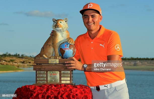 Rickie Fowler of the United States poses with the trophy after winning the Hero World Challenge at Albany Bahamas on December 3 2017 in Nassau Bahamas