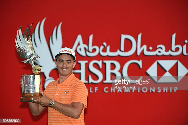 Rickie Fowler of the United States poses with the winners trophy after round four of the Abu Dhabi HSBC Golf Championship at the Abu Dhabi Golf Club...