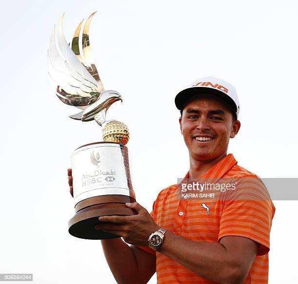 Rickie Fowler of the United States poses with the winners trophy after winning the final round of the Abu Dhabi Golf Championship in the capital of...