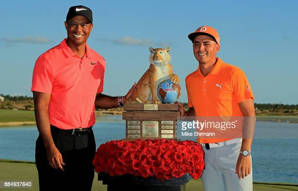 Rickie Fowler of the United States poses with tournament host Tiger Woods after winning the Hero World Challenge at Albany Bahamas on December 3 2017...