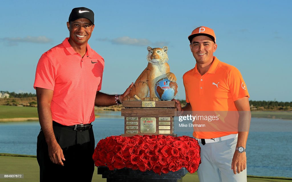 Rickie Fowler of the United States poses with tournament host Tiger Woods after winning the Hero World Challenge at Albany, Bahamas on December 3, 2017 in Nassau, Bahamas.