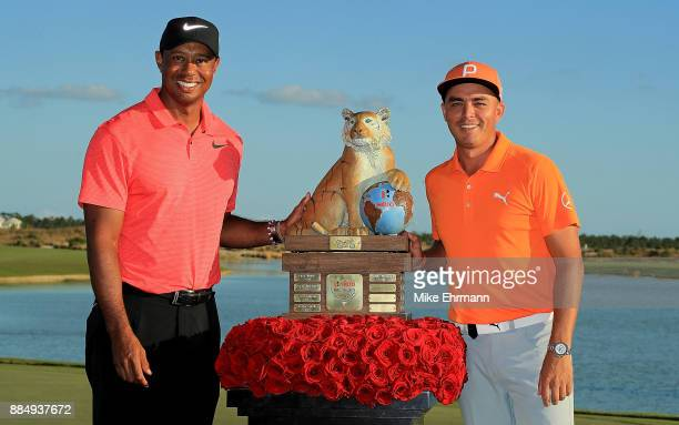 Rickie Fowler of the United States poses with tournament host Tiger Woods after winning the Hero World Challenge at Albany, Bahamas on December 3,...