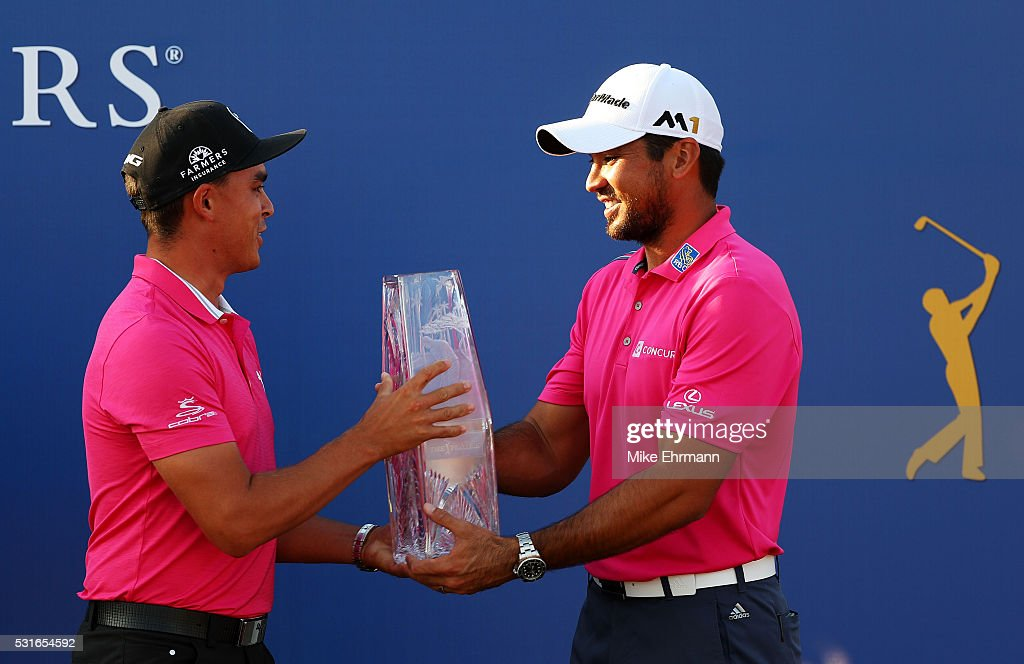 Rickie Fowler (L) of the United States presents the trophy to Jason Day of Australia after Day won the final round of THE PLAYERS Championship at the Stadium course at TPC Sawgrass on May 15, 2016 in Ponte Vedra Beach, Florida.