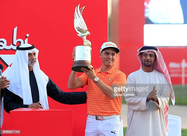 Rickie Fowler of the United States proudly holds the trophy after being presented with the trophy by His Excellency Sheikh Nahyan Bin Mubarak Al...