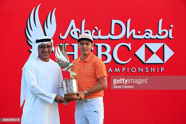 Rickie Fowler of the United States proudly holds the trophy with Abdulfattah Sharaf CEO HSBC United Arab Emirates after his win during the final...