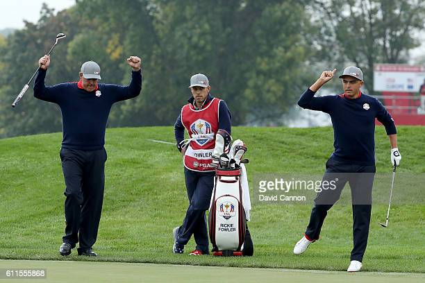 Rickie Fowler of the United States reacts after chipping in on the ninth hole with Phil Mickelson during morning foursome matches of the 2016 Ryder...