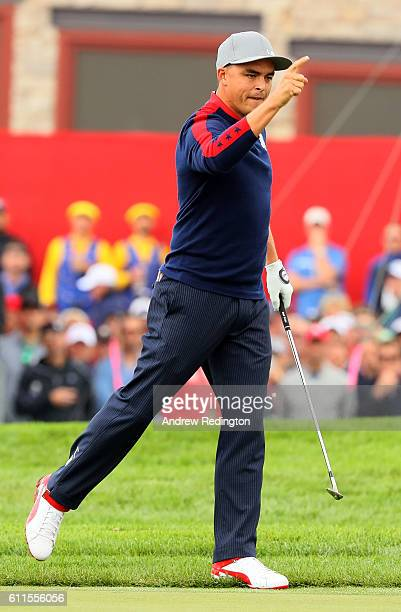 Rickie Fowler of the United States reacts after chipping in on the ninth hole during morning foursome matches of the 2016 Ryder Cup at Hazeltine...