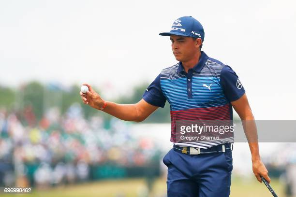 Rickie Fowler of the United States reacts after making a birdie on the first green during the third round of the 2017 US Open at Erin Hills on June...