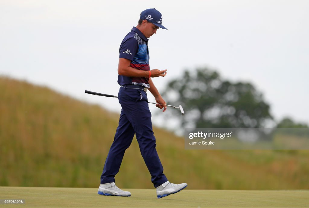 Rickie Fowler of the United States reacts after making a bogey on the 13th green during the third round of the 2017 U.S. Open at Erin Hills on June 17, 2017 in Hartford, Wisconsin.