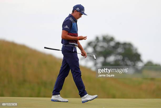 Rickie Fowler of the United States reacts after making a bogey on the 13th green during the third round of the 2017 US Open at Erin Hills on June 17...