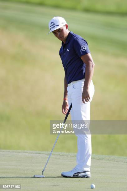 Rickie Fowler of the United States reacts after missing a putt on the 13th green during the second round of the 2017 U.S. Open at Erin Hills on June...