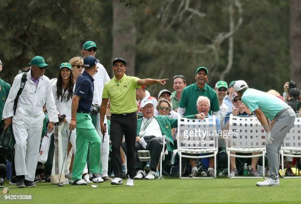 Rickie Fowler of the United States reacts alongside Jordan Spieth of the United States and Justin Thomas of the United States during the Par 3...
