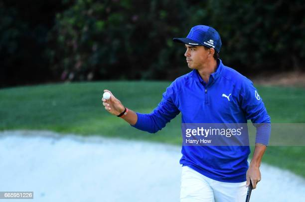 Rickie Fowler of the United States reacts on the 13th green during the second round of the 2017 Masters Tournament at Augusta National Golf Club on...