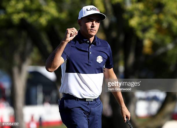 Rickie Fowler of the United States reacts on the 18th green after winning his match during singles matches of the 2016 Ryder Cup at Hazeltine...