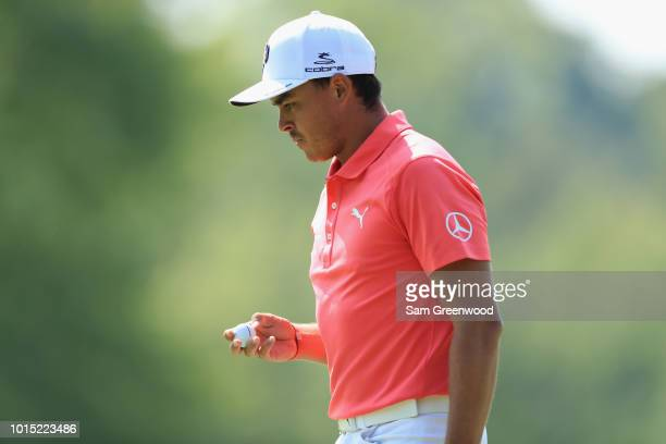 Rickie Fowler of the United States reacts on the eighth green during the third round of the 2018 PGA Championship at Bellerive Country Club on August...