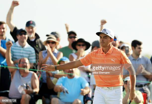 Rickie Fowler of the United States reacts to his birdie on the 12th green during the final round of The Honda Classic at PGA National Resort and Spa...