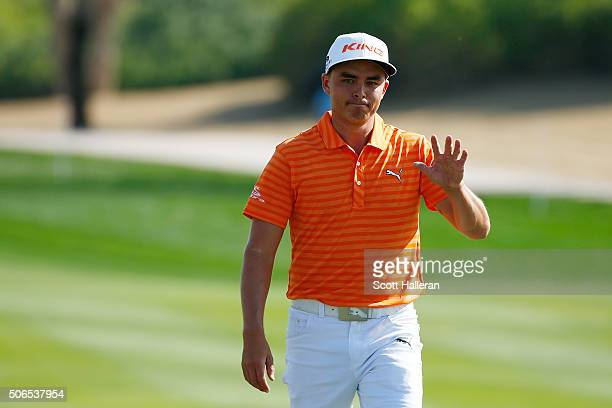 Rickie Fowler of the United States reacts to his eagle on the 8th hole during round four of the Abu Dhabi HSBC Golf Championship at the Abu Dhabi...
