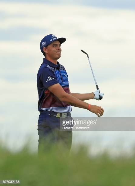 Rickie Fowler of the United States reacts to his shot from the 13th tee during the third round of the 2017 US Open at Erin Hills on June 17 2017 in...