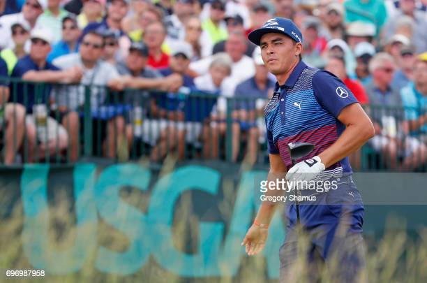 Rickie Fowler of the United States reacts to his shot from the first tee during the third round of the 2017 US Open at Erin Hills on June 17 2017 in...