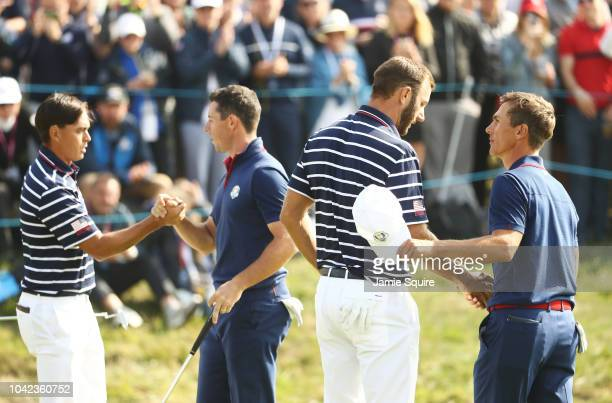 Rickie Fowler of the United States shakes hands with Rory McIlroy of Europe as Dustin Johnson of the United States shakes hands with Thorbjorn Olesen...