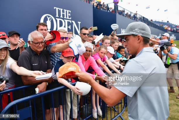Rickie Fowler of the United States signs autographs for fans during a practice round prior to the 146th Open Championship at Royal Birkdale on July...