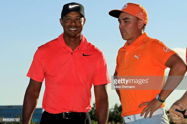 Rickie Fowler of the United States talks with tournament host Tiger Woods after winning the Hero World Challenge at Albany Bahamas on December 3 2017...