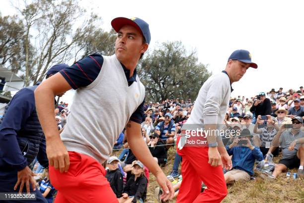 Rickie Fowler of the United States team and Justin Thomas of the United States team walk on the fourth hole during Saturday fourball matches on day...