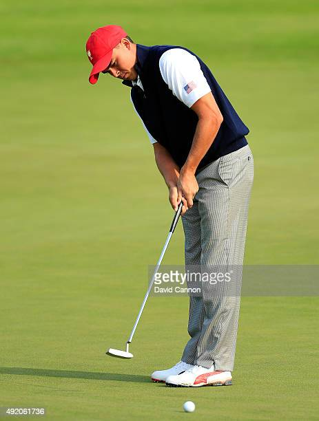 Rickie Fowler of the United States team hits a putt on the seventh hole in his match with Patrick Reed against Louis Oosthuizen and Branden Grace of...