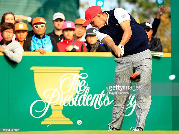 Rickie Fowler of the United States team plays his tee shot on the sixth hole in his match with Patrick Reed against Louis Oosthuizen and Branden...