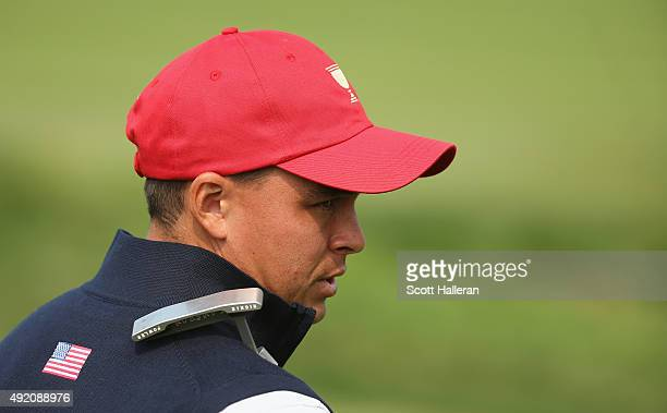 Rickie Fowler of the United States Team waits behind on the 16th green during the Saturday foursomes matches at The Presidents Cup at Jack Nicklaus...