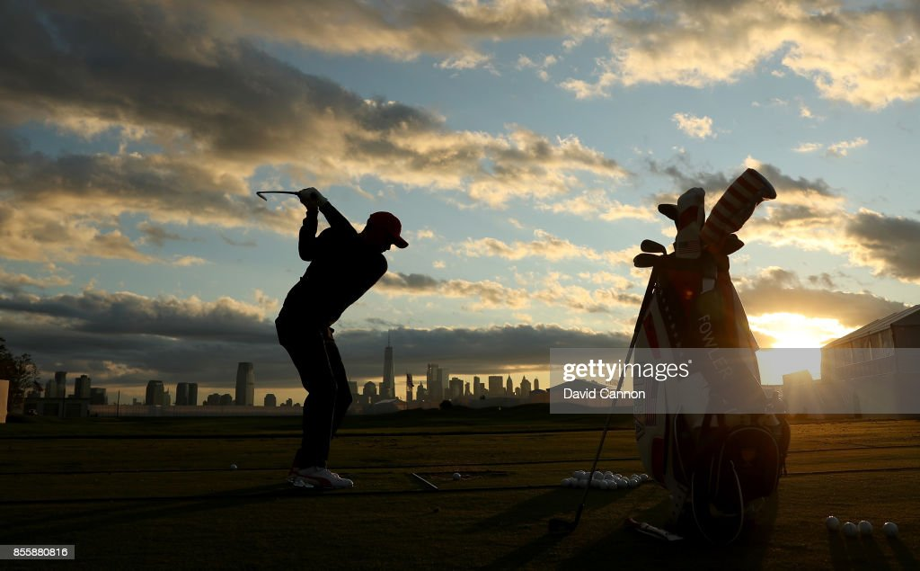 Rickie Fowler of the United States team warms up on the driving range as the sun rises over Manhattan during the Saturday morning foursomes matches in the 2017 Presidents Cup at the Liberty National Golf Club on September 30, 2017 in Jersey City, New Jersey.